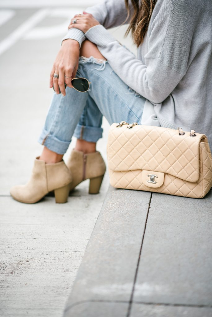 style the girl ripped boyfriend jeans and chanel single flap bag