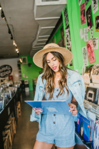 Blue Romper Denim Jacket in vinyl record store