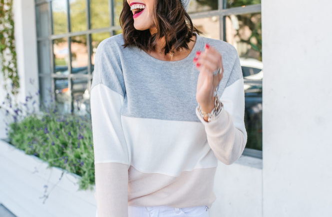 pastel color block sweater with white pants and grey over the knee boots