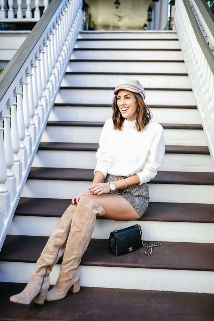 Chicwish Plaid mini skort with white turtleneck sweater and biker boy hat