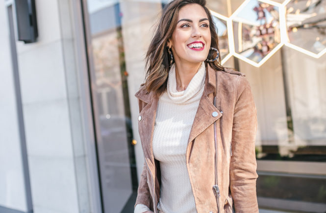 Brown Suede Moto jacket with beige turtleneck and blue skinny jeans