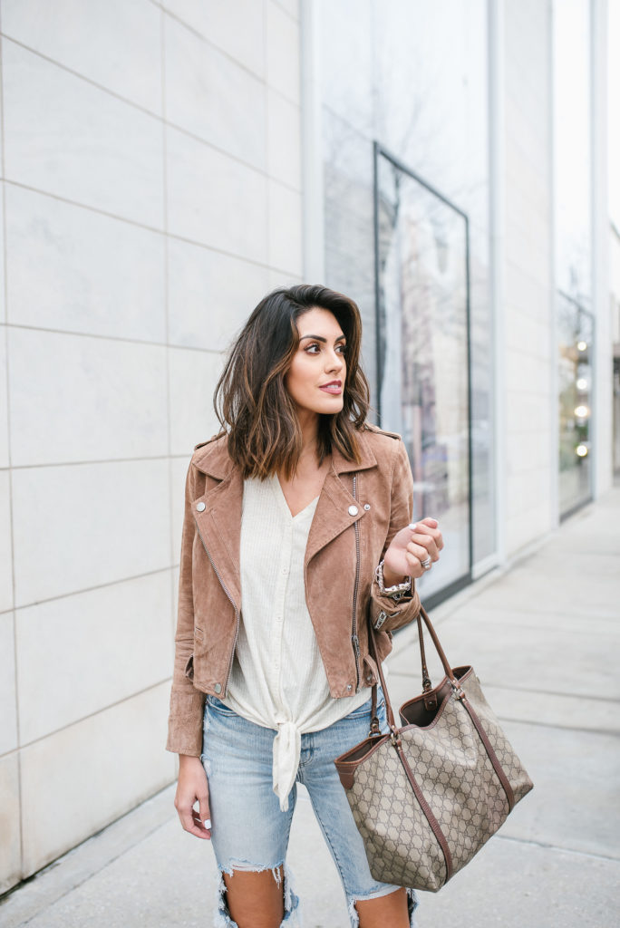Brown Suede Moto jacket with ripped jeans and tie front top with Marc Fisher Western Boot outfit for rodeo